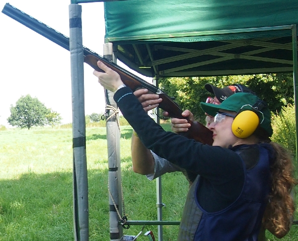 Showing a novice how to break clays for the first time.